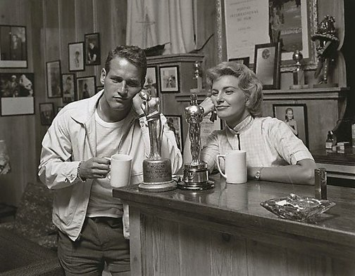 "An image of Paul Newman and Joanne Woodward ""admiring"" their awards. His: 'Noscar' for not having received an Oscar (yet) and Hers; for ""The Three Faces of Eve"". Photo taken for the Saturday Evening Post in 1958 by Sid Avery"