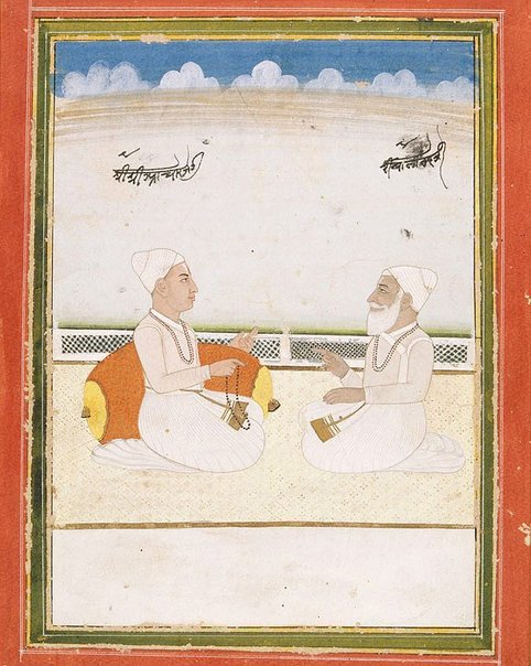 An image of Priest of Jaipur instructing the priest of the Hanuman Temple by