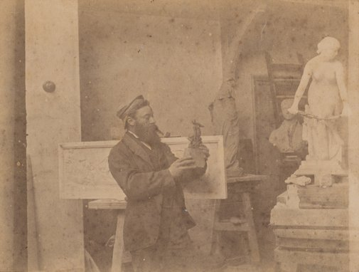 An image of Untitled (portrait of a man with pipe holding a sculpture) by Robert Hellis