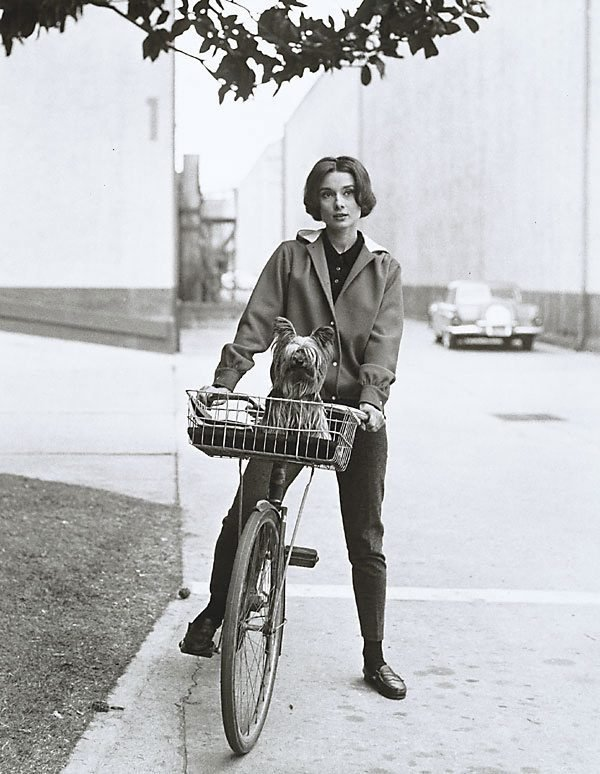 An image of Audrey Hepburn on her bike at Paramount