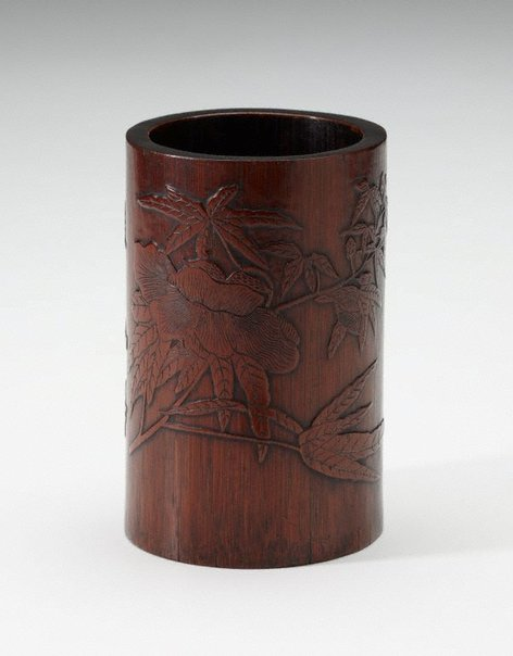 An image of Bamboo brush pot decorated with carved plants and a poem in low relief by