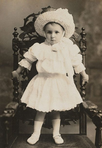 An image of Untitled (portrait of young girl standing on a chair) by Unknown, Tesla Studio, Sydney