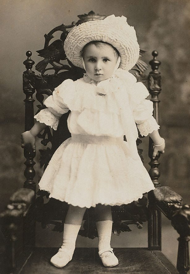 An image of Untitled (portrait of young girl standing on a chair)