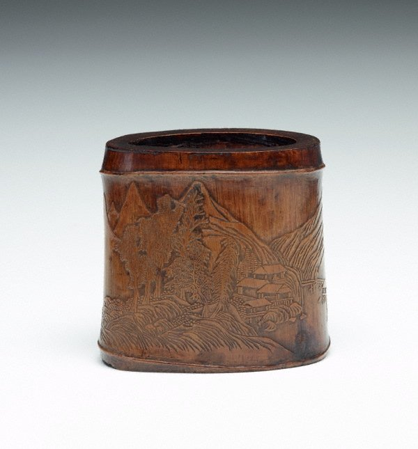 An image of Bamboo brush pot decorated with landscape and pavilion in low relief