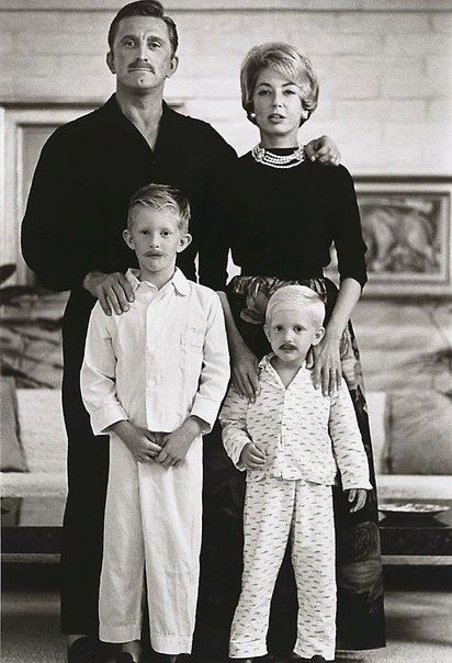 An image of The Douglas family portrait, Kirk, his second wife Anne, and their two sons, Peter Vincent and Eric Anthony. Photographed at their Beverley Hills home by Sid Avery