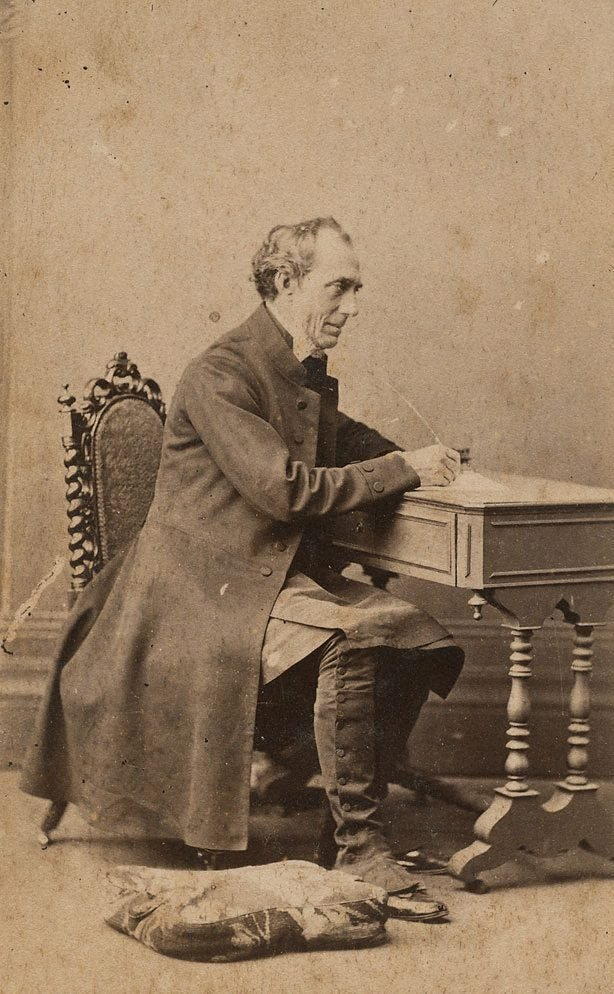 An image of Untitled (portrait of a man seated at desk)