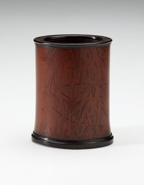 An image of Bamboo brush pot decorated with bamboo motif and Chinese verses in low relief by