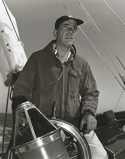 "An image of Humphrey Bogart at the helm of his 55 foot yacht ""Santana"" by Sid Avery"