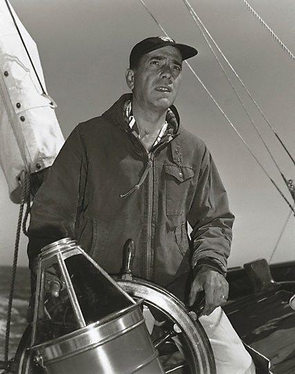 "An image of Humphrey Bogart at the helm of his 55 foot yacht ""Santana"""