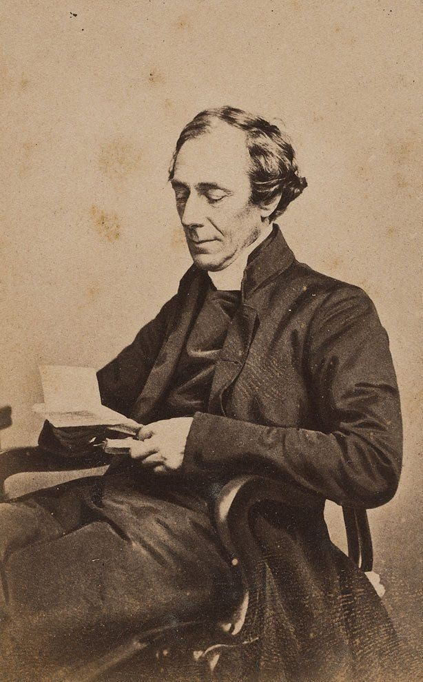 An image of Untitled (portrait of a man seated reading)