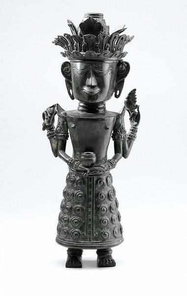 An image of Figure holding bowl (God 'Dewi Sri', God of Rice) by