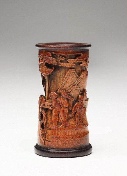 An image of Bamboo brush pot decorated with three human figures in front of a pavilion in high relief by