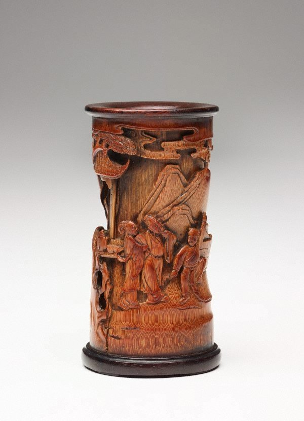 An image of Bamboo brush pot decorated with three human figures in front of a pavilion in high relief
