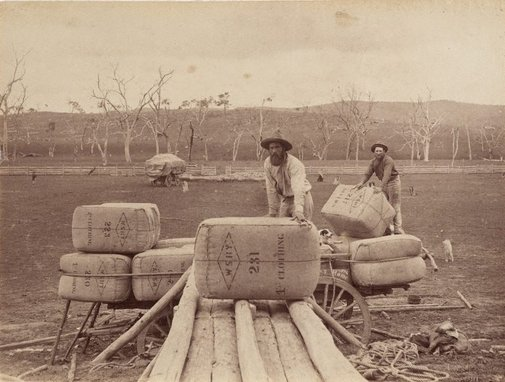 An image of Stacking wool bales onto a cart by Charles Bayliss