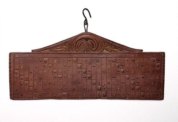 An image of Carved wooden Balinese calendar ('tika')