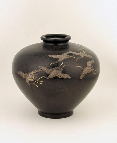 An image of Vase with design of cranes in flight by Meiji export ware
