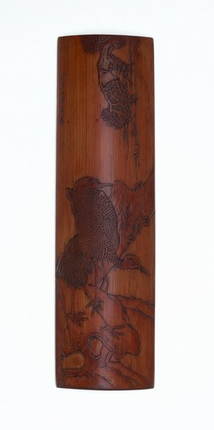 An image of Bamboo wrist-rest carved with two cranes on rocks under a tree in low relief by