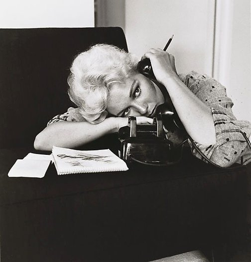 An image of Kim Novak, talking on the phone at her home in Los Angeles, CA by Sid Avery