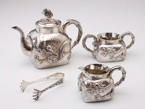 An image of Tea service set, comprising teapot, creamer, sugar bowl and tongs by Unknown