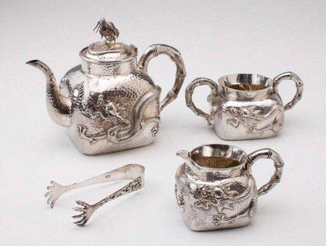 An image of Tea service, comprising teapot, creamer, sugar bowl and tongs