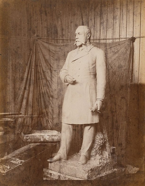 An image of Untitled (sculpture of a man standing holding a rolled document in left hand)