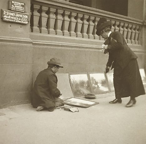 An image of Pavement artist by Harold Cazneaux