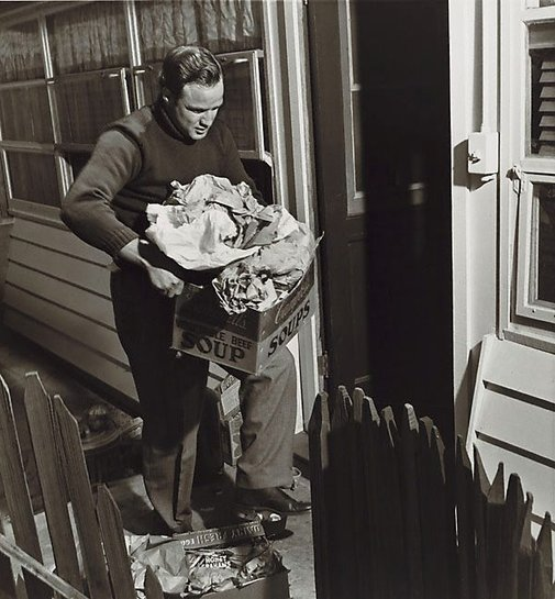 An image of Marlon Brando taking out trash taken 1955 for the Saturday Evening Post by Sid Avery
