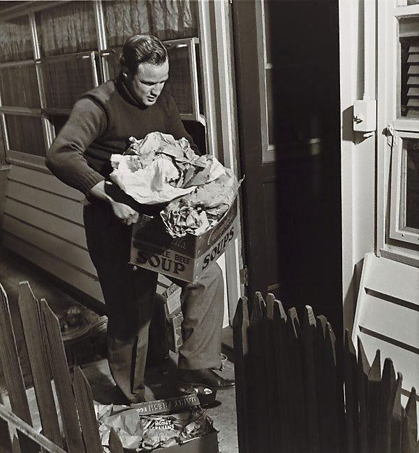 An image of Marlon Brando taking out trash taken 1955 for the Saturday Evening Post