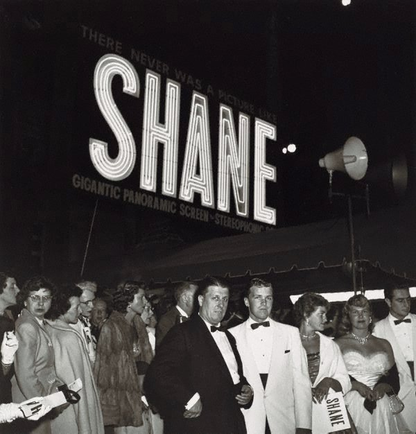 """An image of Director, George Stevens with his son, George Jr at the Hollywood premiere of his movie """"Shane"""""""