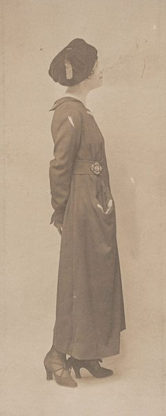 An image of Untitled (young woman in coat and hat) by Francis J Mortimer