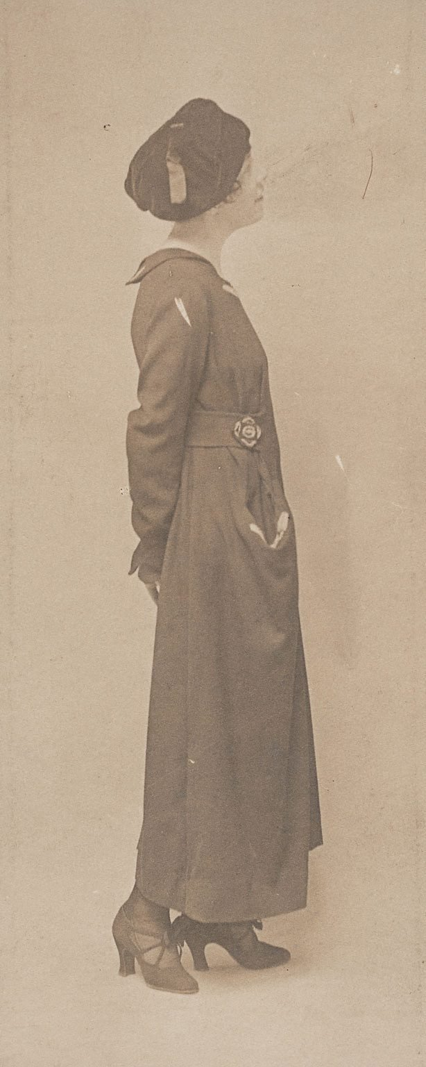 An image of Untitled (young woman in coat and hat)