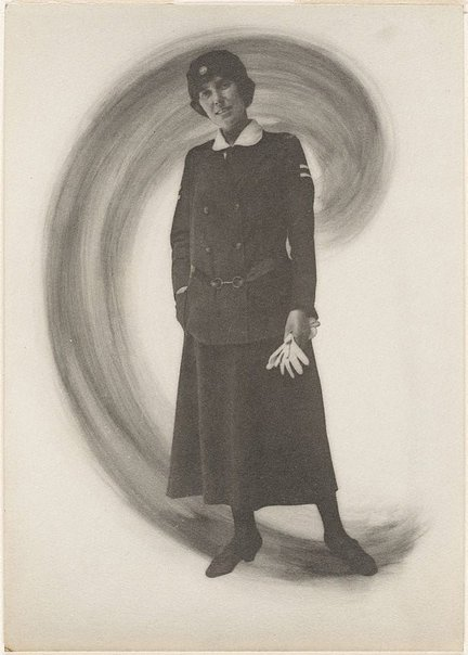 An image of Untitled (woman in uniform holding gloves) by Francis J Mortimer