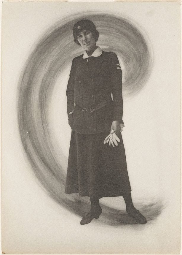An image of Untitled (woman in uniform holding gloves)