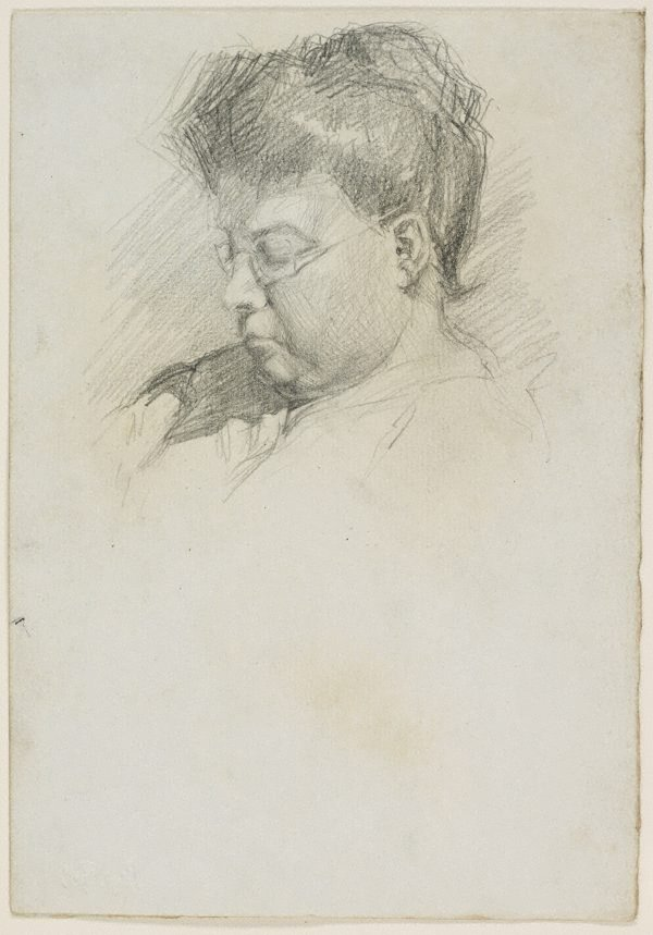 An image of Mother reading, wearing spectacles