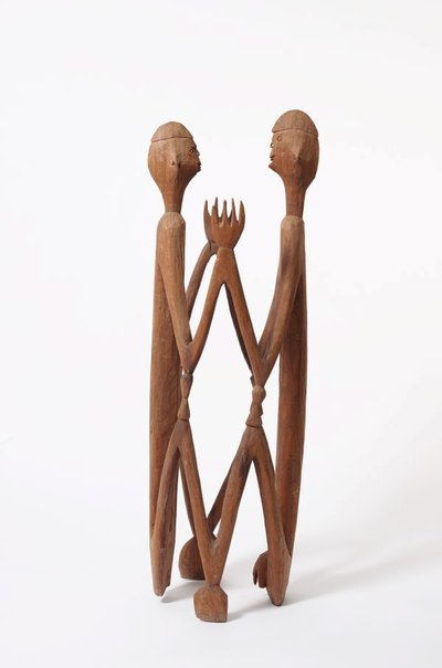An image of Male and female ancestor figures by Asmat people