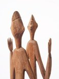 Alternate image of Male and female ancestor figures by Asmat people
