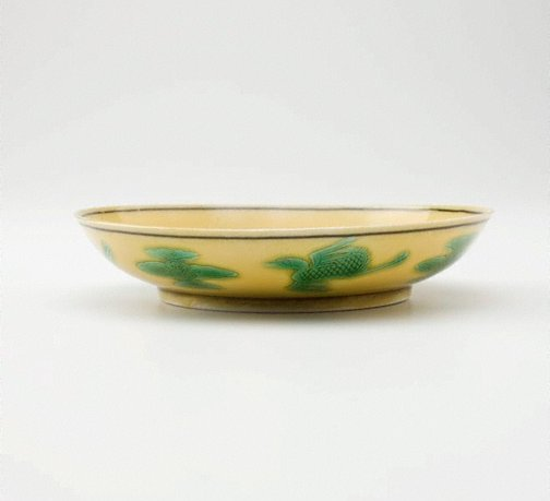 An image of Yellow glazed small dish with dragon by