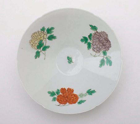 Alternate image of Bowl with floral design and six foliations at rim by