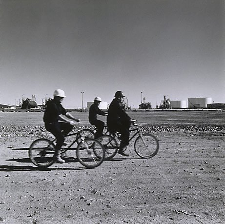 An image of Cyclists, Jackson Oil Facility, Queensland by Tom Balfour