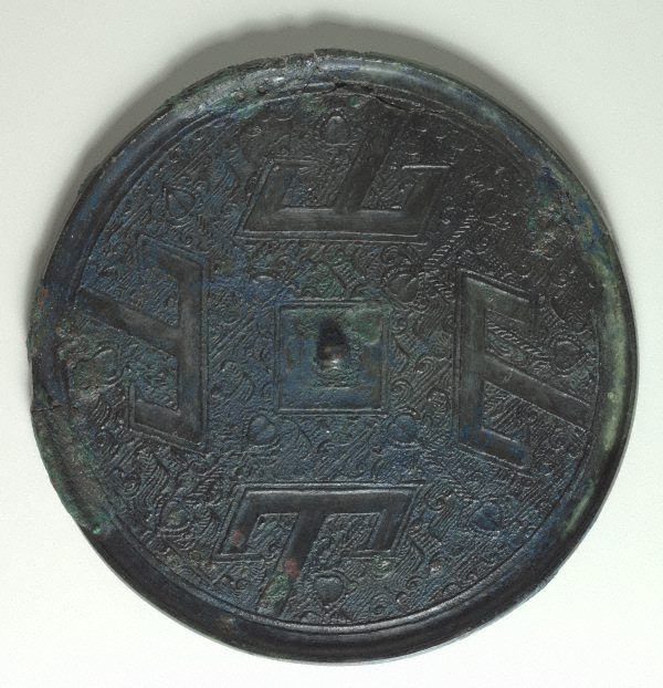 An image of Mirror with T-motif design