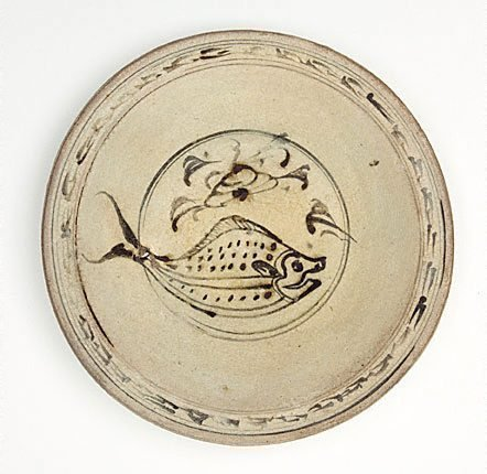 An image of Deep dish with design of fish by Sukothai ware