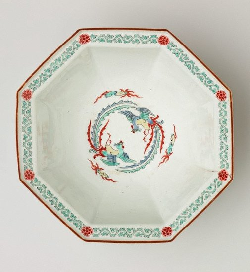 An image of Octagonal bowl with design of two phoenixes on the interior and pine and flowering plum trees on the exterior by Arita ware