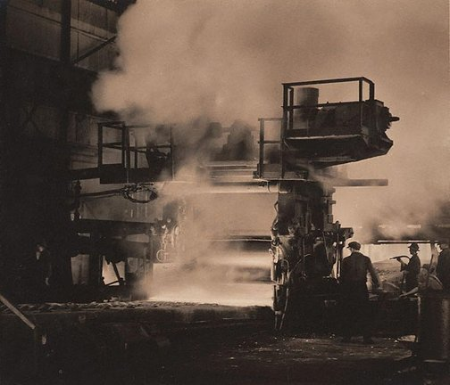 An image of Rolling steel plates, B.H.P. Pty. Co. Ltd. by Harold Cazneaux