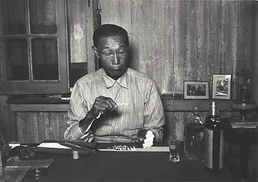 An image of Sam Sue, well known pearl buyer, Broome, Western Australia by Axel Poignant