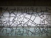 White Styrofoam on black wall, (1994) by Sol LeWitt