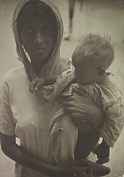 An image of Indian woman and child