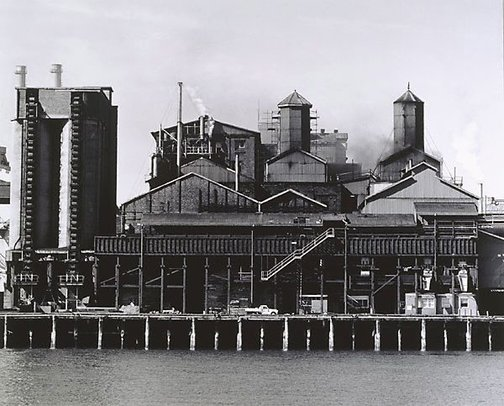 An image of Refinery and coal silos by Mark Johnson