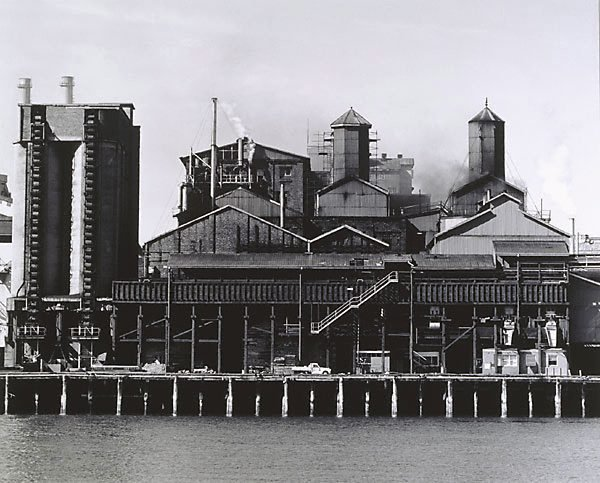 An image of Refinery and coal silos