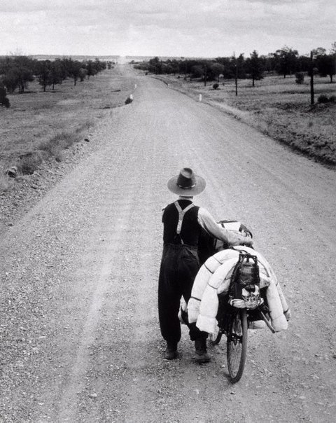 An image of Swagman on the road to Wilcannia, New South Wales by Axel Poignant