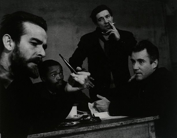 An image of Athol Fugard (author), Zaiks Mokae, John Berry (director) and Ian Bannen in rehearsals for 'The blood knot', New Arts Theatre, London